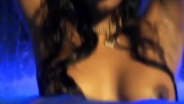 female bathing topless