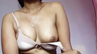 Desi girl stripping and masturbating with a big black dildo