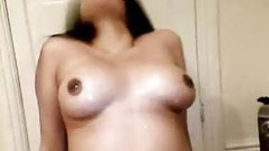 Hot indian chick playing with her tits