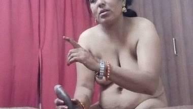 Reluctant Mumbai aunty shaking penis and sucking it