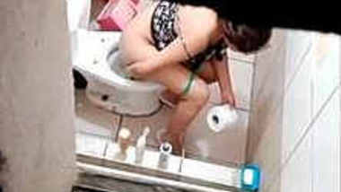 girl caught pooping