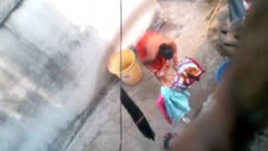 Indian Bengali newly wed wife bathing in open caught voyeur