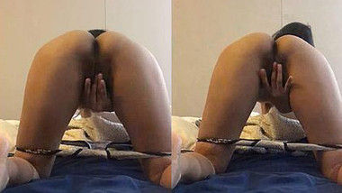 Horny Bitch in Bed Playing with her Boobs and Pussy.