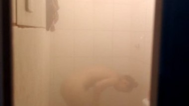 Filming sexy cousin taking shower