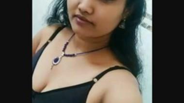 Sexy girl using selfie stick