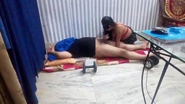 Indian girlfriend giving her boyfriend a blowjob