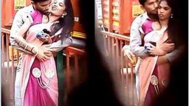 Voyeur films a man who hugs Desi babe and feels up her XXX boobs