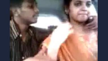Tamil guy smooching and pressing boobs of cute girl in car