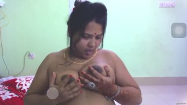 Sexy aunty displays soft boobs and licks nipples before masturbation