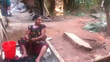 Chubby Indian temptress loves her sex hole and washes it in a trough