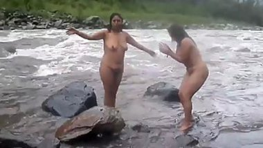 Two fat Desi women show their XXX assets while relaxing naked in river