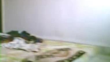 Slim Indian coed having sex inside the dorm.