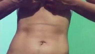 Porn video where aspiring Desi webcam model exposes tits and belly