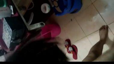 Boyfriend lies on the floor to receive handjob by Desi girl in porn video