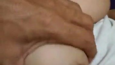 Guy can't resist Indian aunty's naked titties and greedily paws them
