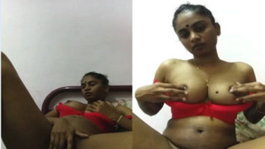 Sexy Indian girl pulls sex red lingerie down to flash her XXX titties