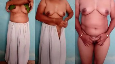 Indian Bhabhi wife strips naked to tease operator with XXX curves