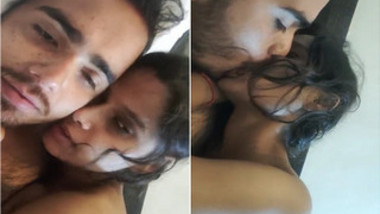 Indian chick dramatically kisses her partner in bed in soft porn video