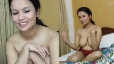 Smiling Indian female is shy but still exposes XXX boobies in sex show