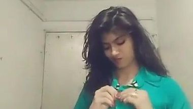Indian teen unbuttons green shirt and takes it off just like her bra