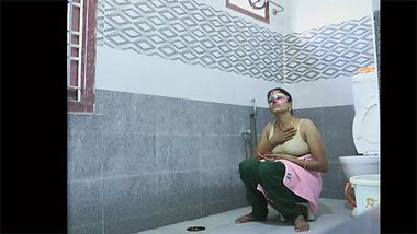 Mysterious Indian woman in purple mask washes nice body on camera